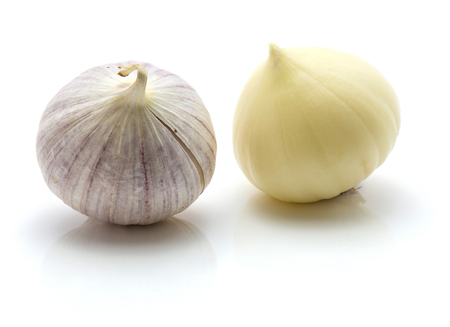 Two bulbs of solo garlic isolated on white background one bulb peeled one whole