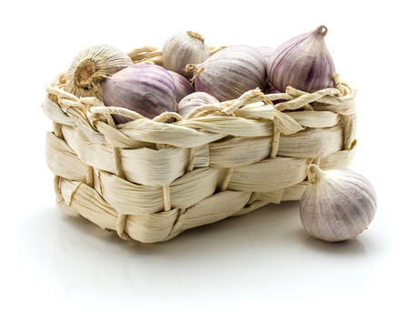 Solo garlic in straw basket isolated on white background single clove