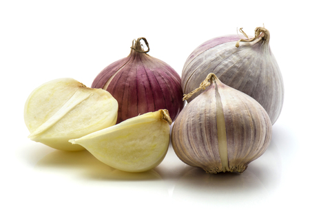 Three whole, one half, quarter of solo garlic isolated on white background
