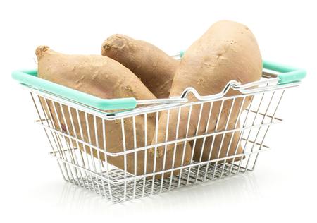 Sweet potato in a shopping basket isolated on white background
