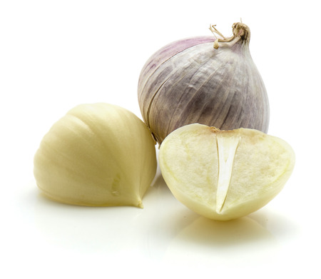 One whole solo garlic and two sliced halves isolated on white background