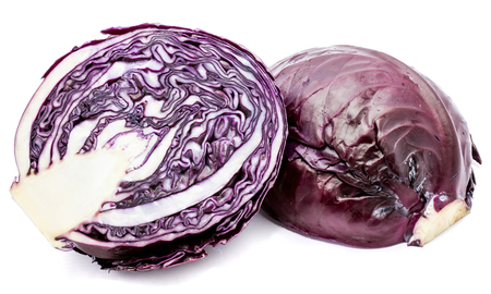Two sliced halves of one whole purple cabbage isolated on white background  Stock Photo