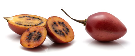 Tamarillo isolated on white background one whole one half and two slices