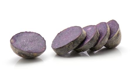 Sliced vitelotte potato isolated on white background five purple slices  Stock Photo