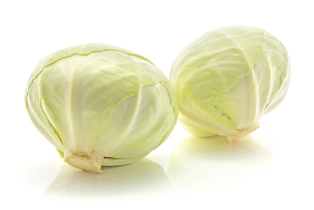 White cabbages isolated on white background two whole heads