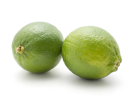 Two limes isolated on white background ripe fresh  Stock Photo
