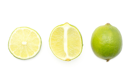 Limes collection top view isolated on white background one whole one half and one ring slice