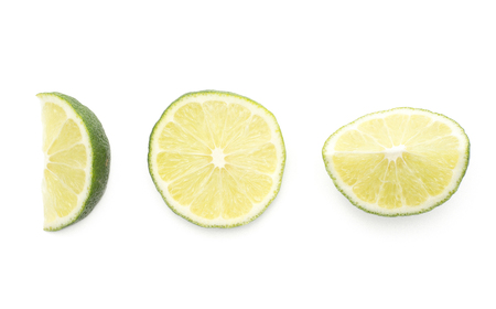 Lime slices collection top view isolated on white background