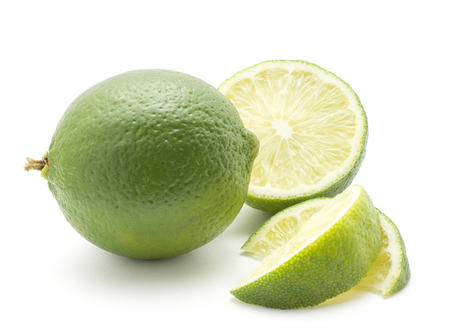 Lime (one whole, one half, two slices) isolated on white background