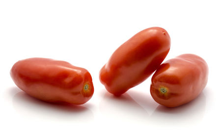 San Marzano tomato isolated on white background three whole red