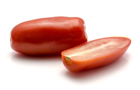 San Marzano tomato isolated on white background one whole and sliced half Stok Fotoğraf