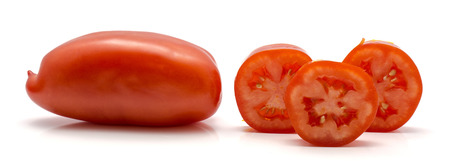 One whole San Marzano tomato and three rings isolated on white background Stok Fotoğraf