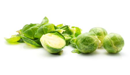 Boiled Brussels sprout leaves stack three heads and one half isolated on white background  Stock Photo