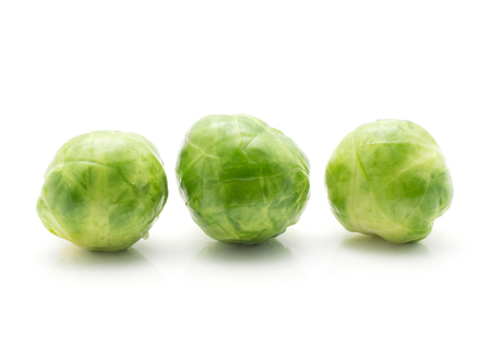 Boiled Brussels sprout isolated on white background three whole heads in row  Stock Photo