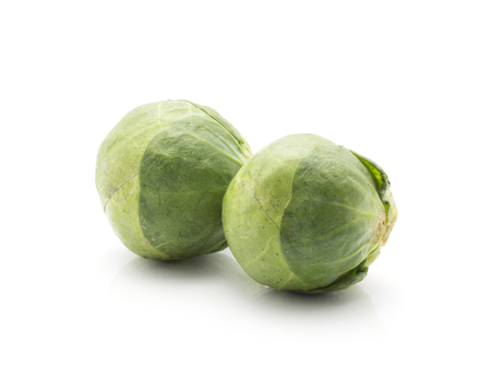 Raw Brussels sprout two heads isolated on white background