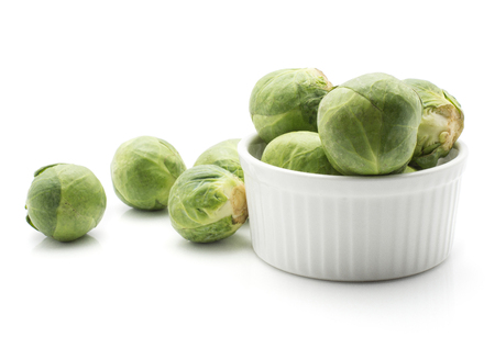 Raw Brussels sprout heads in ceramic mold isolated on white background  Stock Photo