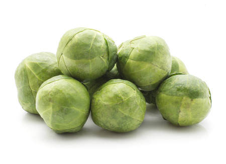 Fresh Brussel sprout stack isolated on white background raw  Stock Photo