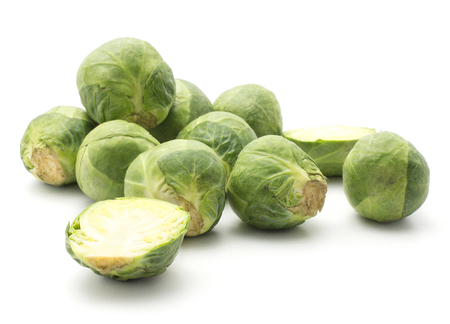 Raw Brussels sprout stack isolated on white background heads two sliced halves