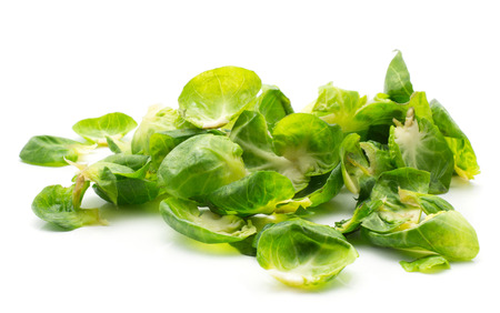Boiled Brussels sprout leaves stack isolated on white background