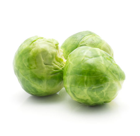 Boiled Brussels sprout isolated on white background three whole heads