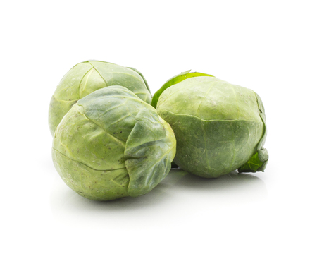 Raw Brussels sprout isolated on white background fresh three heads  Stock Photo