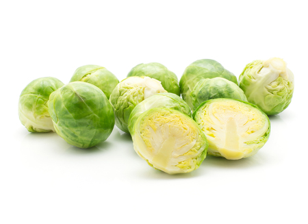 Boiled Brussels sprout heads heap isolated on white background