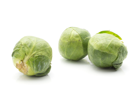 Brussels sprout three raw heads isolated on white background  Stock Photo