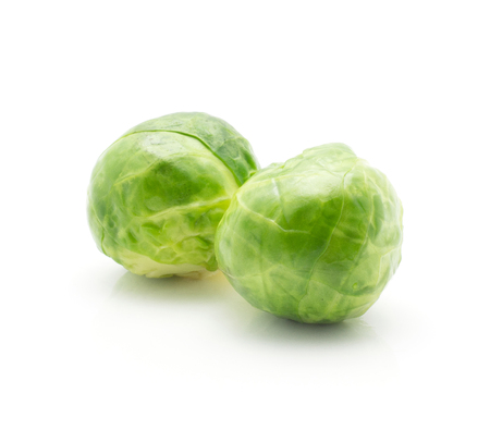 Boiled Brussels sprout isolated on white background two whole heads  Stock Photo