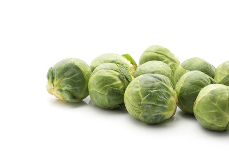 Raw Brussels sprout heads isolated on white background