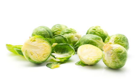 Boiled Brussels sprout leaves stack several heads and two halves isolated on white background  Stock Photo
