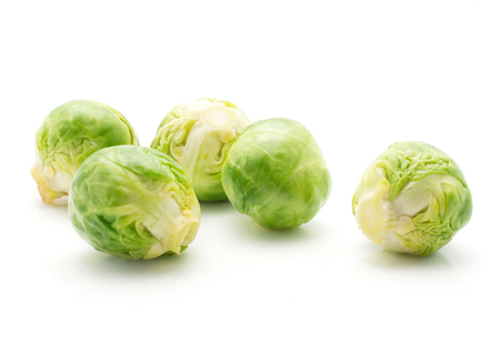 Boiled Brussels sprout five heads isolated on white background