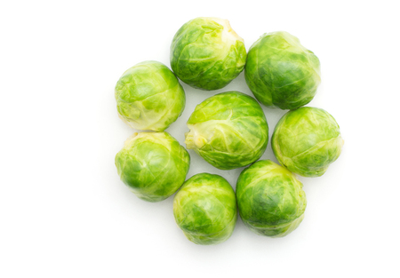 Boiled Brussels sprout heads folded like flower top view isolated on white background  Stock Photo