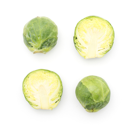 Brussels sprout two raw heads and two halves top view isolated on white background