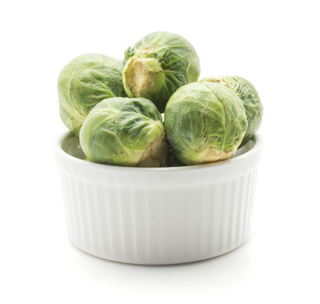 Brussels sprout heads in a ceramic mold isolated on white background raw fresh