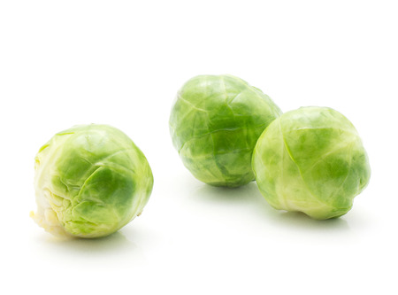 Boiled Brussels sprout isolated on white background three heads  Stock Photo
