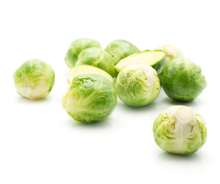 Boiled Brussels sprout heads isolated on white background