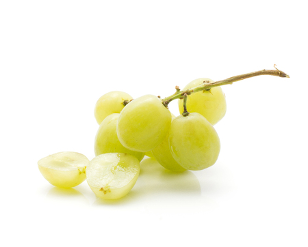One green grape bunch with two berry halves (Early Sweet or Grapaes variety) isolated on white background