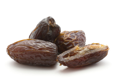 Date fruit Medjool variety three whole and one half isolated on white background