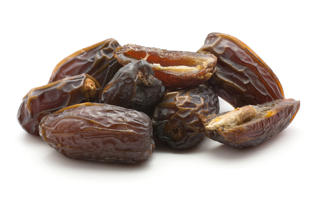 Date fruit stack Medjool variety isolated on white background