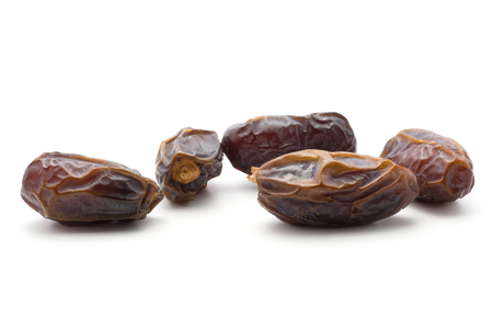 Date fruits Medjool isolated on white background five ripe and dried