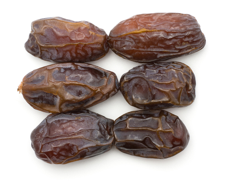 Date fruit Medjool six whole ripe dried top view isolated on white background