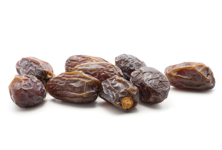 Date fruit Medjool stack isolated on white background