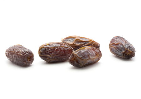 Five date fruits Medjool isolated on white background