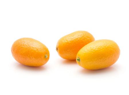 Kumquat isolated on white background three ripe  Stock Photo