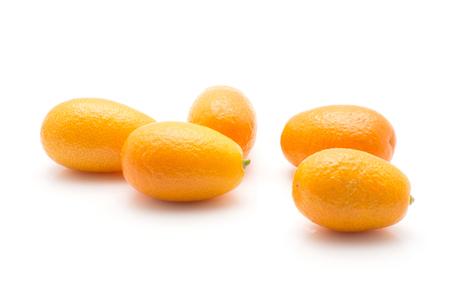 Five kumquat isolated on white background