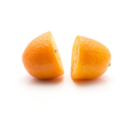 Kumquat two halves isolated on white background  Imagens