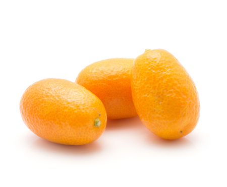 Three kumquat isolated on white background  Stock Photo