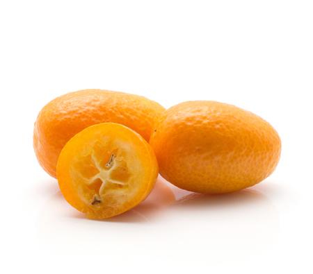 Two kumquat one half isolated on white background  Stock Photo