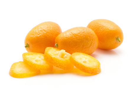 Three kumquat and four sliced rings isolated on white background