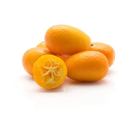 Kumquat stack whole with one half isolated on white background